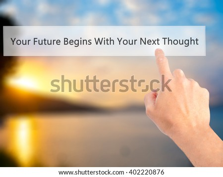 Your Future Begins With Your Next Thought - Hand pressing a button on blurred background concept . Business, technology, internet concept. Stock Photo