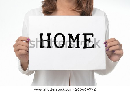 Your girl holds a cardboard sign. Home - stock photo