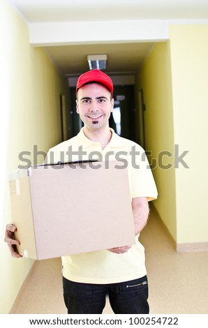 Your handsome delivery man during his work - stock photo