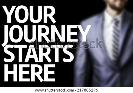 Your Journey Starts Here written on a board with a business man on background - stock photo