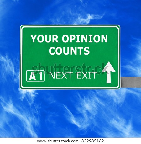 YOUR OPINION COUNTS road sign against clear blue sky - stock photo