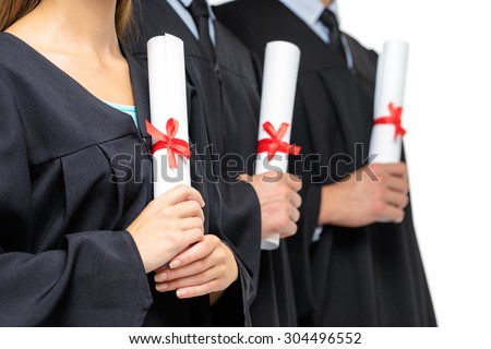 Youth and education. Happy graduates. Close up of students holding certificates. Isolated on white.