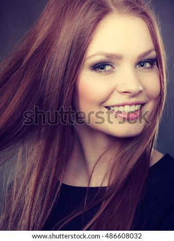 Youth and self-care. Young pretty woman portrait in make up. Face of beauty girl with straight smoothy hair and casual makeup.