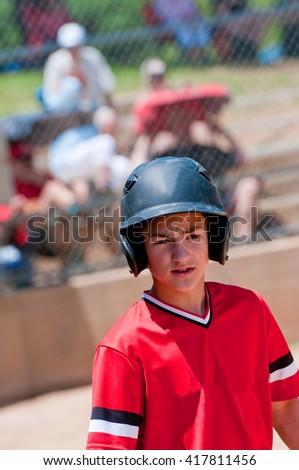 Youth baseball boy ready to bat, looking confident. - stock photo