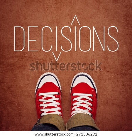 Youth Decision Making Concept, Feet in Red Sneakers from Above Standing at Ground with Decisions Title Printed, Top View - stock photo