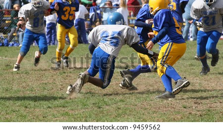 Youth Football Game Play Action - stock photo