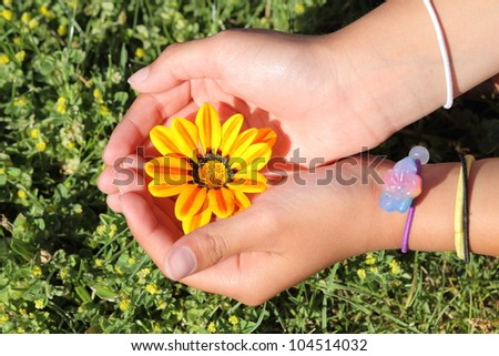 Youth girl cradling a flower