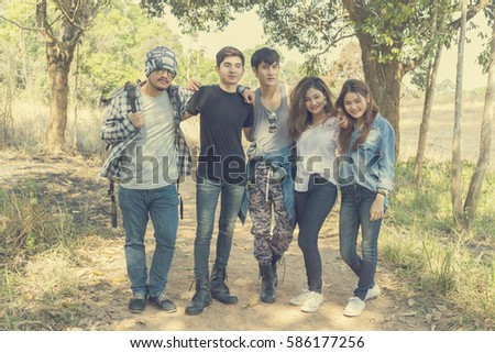 youth group vacation travel National Park,young people in autumn park,Young Asian Backpacker Camping Hiking Journey Travel Trek Concept. Camp Forest Adventure Travel Remote Relax Concept,THAILAND
