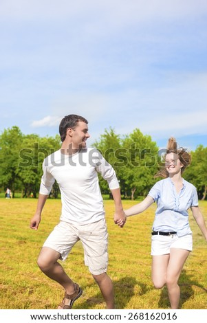 Youth Lifestyle Concept: Beautiful Caucasian Couple Having Their Outdoor Holiday Together. Vertical Image Composition - stock photo