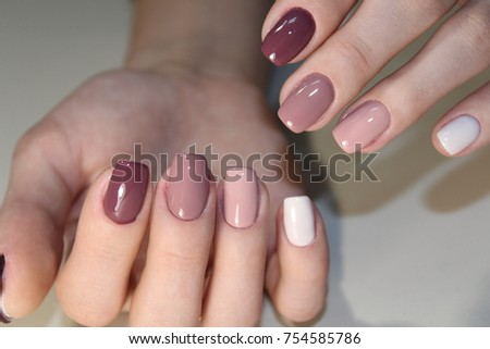 Youth manicure design, beautiful female hands with sexy manicure.