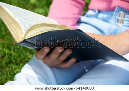Youth reading the Bible - stock photo