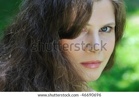 Youth series - portrait of beautiful young woman with hair through one eye