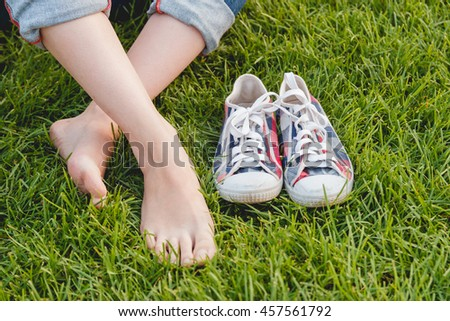 Youth Sneakers on Grass Sunny Serene Summer Day