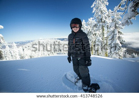 Youth snowboarder  - stock photo