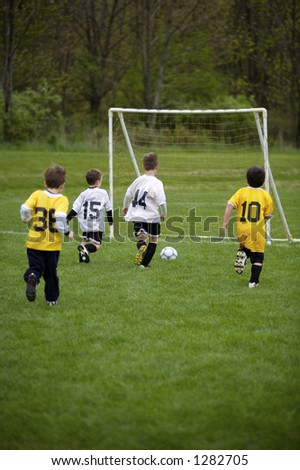 Youth Soccer Game.  White Team ready to Score - stock photo