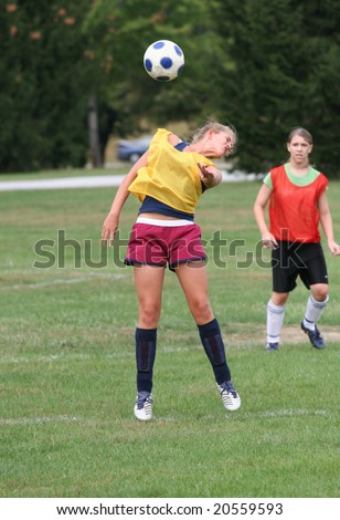 Youth Teen Bouncing Soccer Ball - stock photo