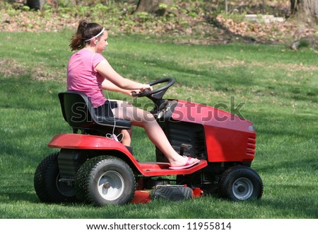 Youth Teen Girl Mowing Grass on Tractor Lawn Mower 2 - stock photo
