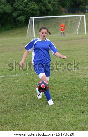Youth Teen Soccer Player Ready to Kick Ball - stock photo