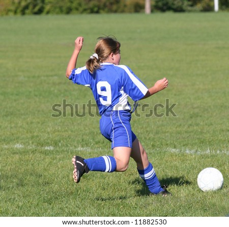 Youth Teen Soccer Player Ready to Kick Ball During Game. - stock photo