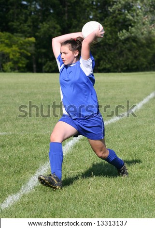 Youth Teen Soccer Player Ready to Throw Ball Back into Game. - stock photo
