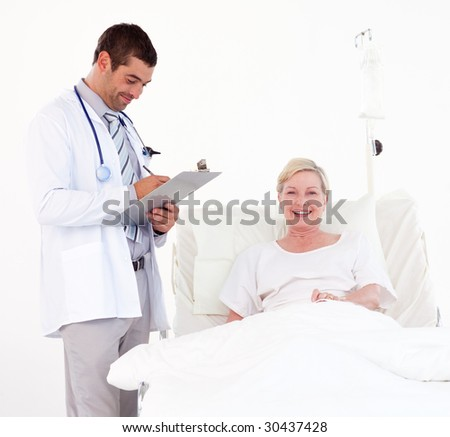 Youthful team of Doctors helping a patient - stock photo
