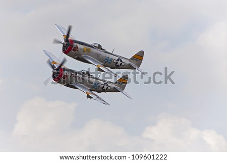 YPSILANTI - AUGUST 4 : A pair of P-47 Thunderbolts make a pass at the Thunder over Michigan air show  August 4, 2012 in Ypsilanti, Michigan. - stock photo