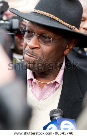 YPSILANTI, MI - NOVEMBER 10th: A stern faced Herman Cain meets with reporters, November 10, 2011 in Ypsilanti, MI