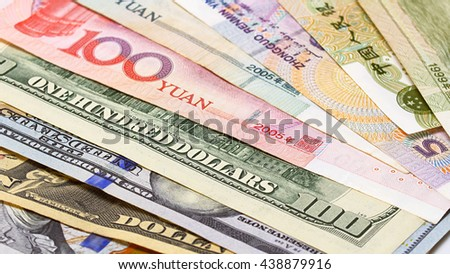 Yuan vs Dollar bank notes concept business background