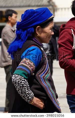 Yuan Yang , China April, 2015. Woman Hani nationality looks view on the square. In Yunnan Province is home to many different ethnic Miao Bai, Hani, Naxi and others.