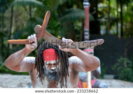 Yugambeh Aboriginal man holds boomerangs during Aboriginal culture show in Queensland, Australia. - stock photo
