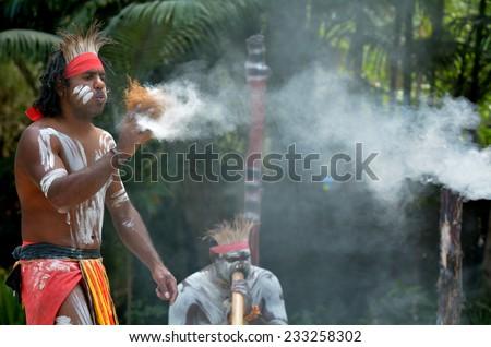 Yugambeh Aboriginal warrior demonstrate  fire making craft during Aboriginal culture show in Queensland, Australia. - stock photo