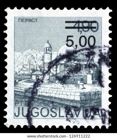 "YUGOSLAVIA - CIRCA 1976: A stamp printed in Yugoslavia shows city views of Perast, with the same inscription, from series ""Yugoslavia city views "", circa 1976"