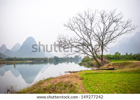 Yulong River is a small tributary of the larger Li River in Southeastern Guangxi Zhuang Autonomous Region that runs through the major city of Guilin to Yangshuo, located in  Guangxi Province, China. - stock photo