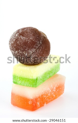 Yummy Candies! Three colorful candies on white background. - stock photo