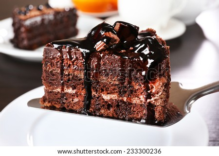 Yummy chocolate cake served on table, close-up - stock photo