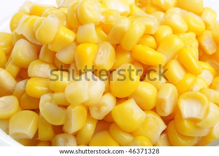Yummy yellow corn grain in plate (close up)