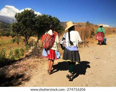 YUNGAY, PERU - AUGUST 23: Peruvian peasant women returning from the market of Huaraz, Peru South America, August 23 2012 - stock photo