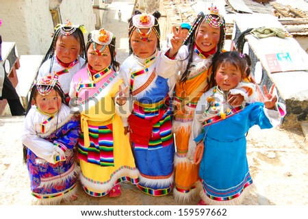 YUNNAN, CHINA - MARCH 20 : Unidentified Chinese Tibetan girls dress in traditional costume on March 20, 2008 in, Yunnan, China.  - stock photo