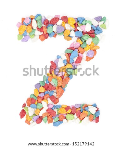 Z alphabet colorful gravel on white background.