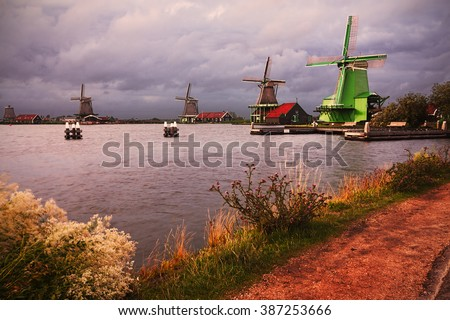 Zaanse schans, holland; characteristic windmills. - stock photo