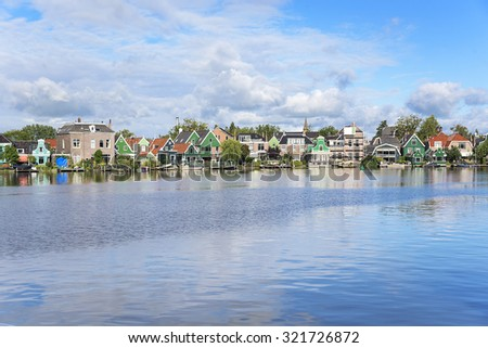 Zaanse Schans. Picturesque view of a Dutch village located at the river. - stock photo