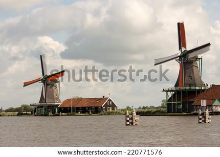 zaanse schans windmills typical dutch landscape - stock photo