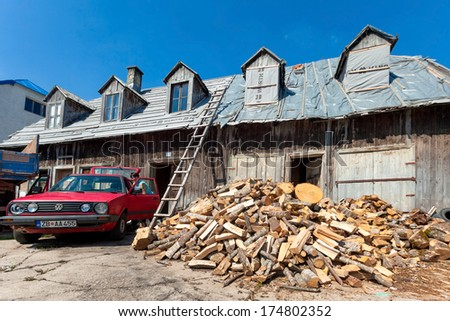 ZABLJAK, MONTENEGRO - AUG 17, 2012: Pile of wood in front of the old wooden house in Zabljak, Montenegro on August 17, 2012. Zabljak is the city on the highest altitude of the Balkans.
