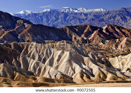 Zabriskie Point Snowy Panamint Mountains Death Valley National Park California - stock photo
