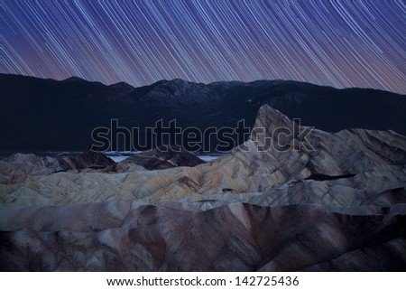 Zabriskie Point star trails, Death Valley, California, USA - stock photo