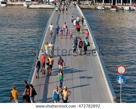ZADAR, CROATIA - JULY 10, 2016: Summer scene of the people crossing bridge leading to peninsula and old town