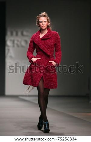 ZAGREB, CROATIA - APRIL 2: Fashion model wears clothes made by Tihomir Krznaric in 'Croaporter' show, April 2, 2011 in Zagreb, Croatia. - stock photo