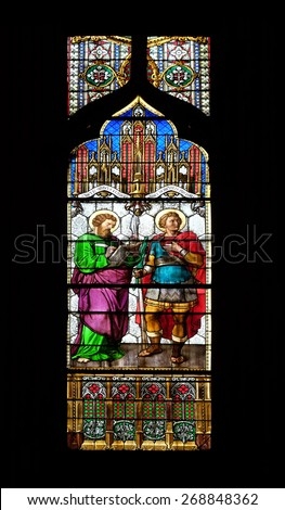 ZAGREB, CROATIA - APRIL 04: Saint Mark and Demetrius, stained glass in Zagreb cathedral dedicated to the Assumption of Mary and to kings Saint Stephen and Saint Ladislaus in Zagreb on April 04, 2015 - stock photo