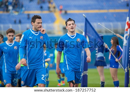 ZAGREB, CROATIA - APRIL 12, 2014: 1st Croatian Football League Championship - Dinamo VS Rijeka. Armada, Rijeka supporters on stands, Jerko LEKO (27) and Arijan ADEMI (7) after the game - stock photo