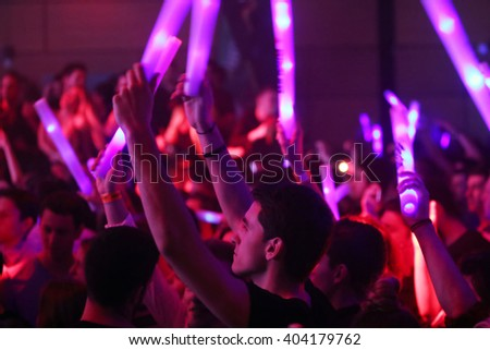 ZAGREB, CROATIA - APRIL 9, 2016 : The audience with illuminating sticks on La Fiesta Stage by Sensation party in Hypo center in Zagreb, Croatia.